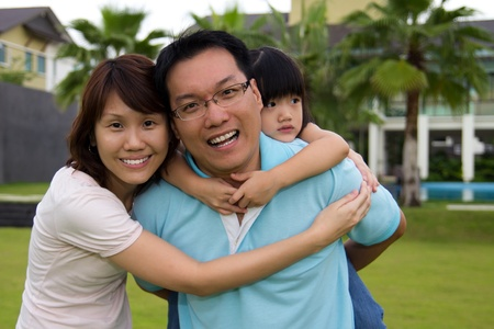 Happy family portrait at outdoor, smile and looking into camera photo