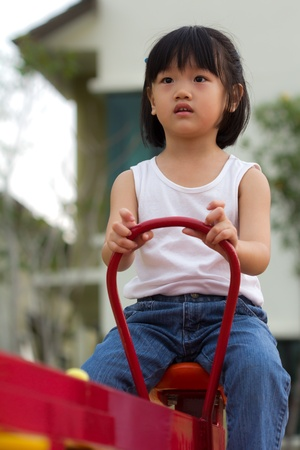 childishness: Little girl is playing at the playground