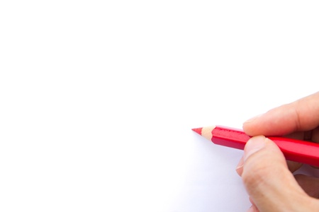pencil writing: Hand holds a red color pencil with a white background for text