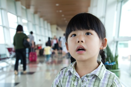 Little girl in boarding room at the airport terminal Stock Photo
