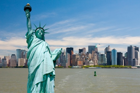 New York city tourism conceptual, Statue of Liberty against Manhattan downtown photo