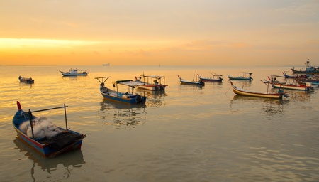 Sunset at the fisherman village on the Pantai Bersih, Penang Malaysia photo