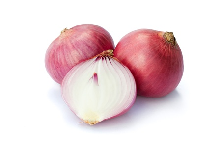 onion peel: Raw red onion isolated on white background