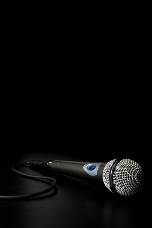 Microphone with cable isolated over a back background photo