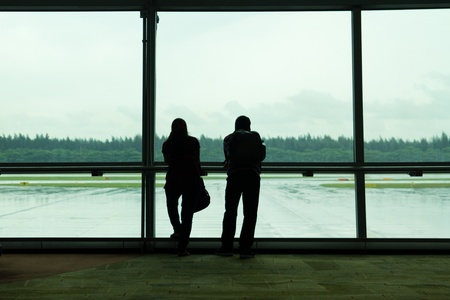 Silhouette of a couple waiting at airport terminal