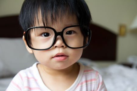 Portrait of a baby girl wearing big spectacles Stock Photo