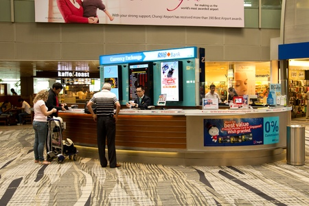 Singapore - April 11, 2012: Foreign currency exchange counter at Singapore Changi Airport, taken on April 11, 2012
