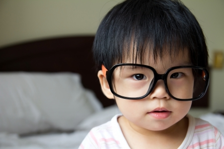 Portrait of a baby girl wearing big spectacles photo