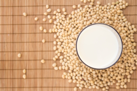 soya bean: Glass of soya milk viewed from top surrounded by soya beans