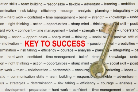 Old metal key to success concept on paper sheet photo