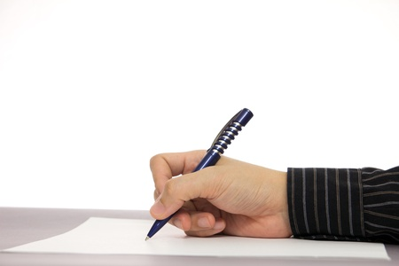 Close up of business man signing a document Stock Photo