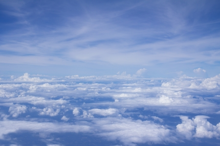Bright blue sky above puffy white clouds