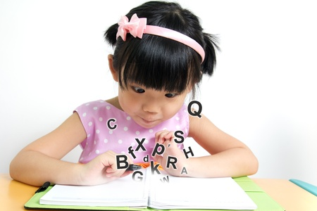 Little girl looks surprise at magic book Stock Photo - 14585986