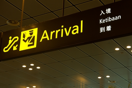 Arrival sign panel in airport with immigration sign
