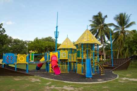 playground equipment: Big colorful children playground equipment in middle of park