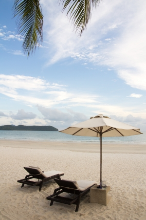 View of beach chair and umbrella on the beach photo