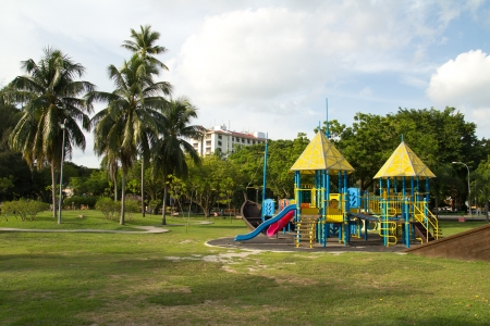 Big colorful children playground equipment in middle of park Stock Photo - 14749527