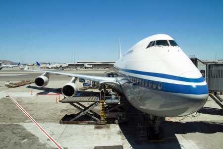 jumbo: Airplane parked at airport terminal with aerobridge connected Editorial