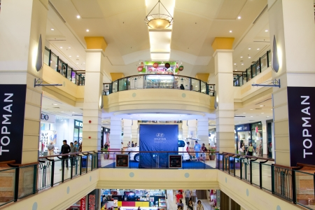Malaysia - July 8, 2012: Interior of a massive multilevel shopping mall in Penang, Malaysia, taken on July 8, 2012