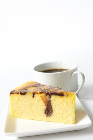 Slice of marble cheese cake with a cup of coffee photo