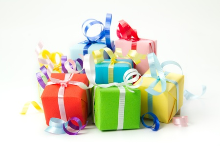 birthday presents: Multi color gift boxes with ribbon isolated on white background