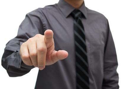 Businessman hand pushing on a virtual interface photo