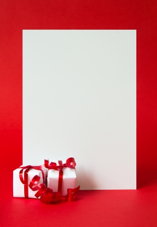 Two wrapped gifts represent christmas theme, with a blank white card for text photo