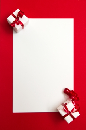 Two wrapped gifts represent christmas theme, with a blank white card for text Stock Photo