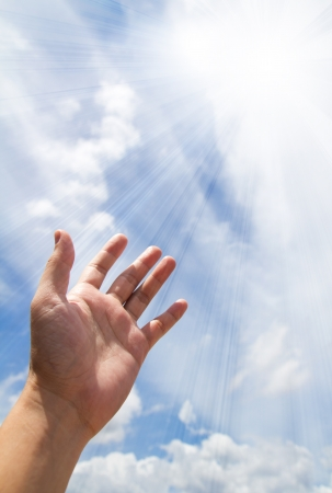 plead: Adult hand reaching out towards the sky
