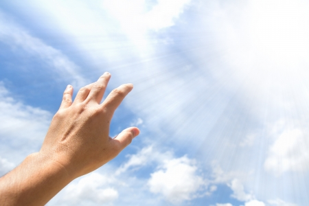 hand of god: Adult hand reaching out towards the sky