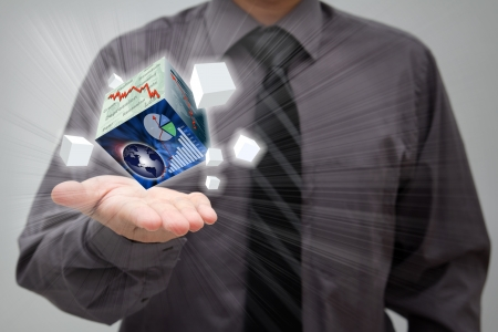 Businessman showing finance cubes in his open palm photo