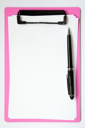 Pink color clip board with blank paper and ball pen photo