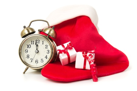 festival moment: Christmas countdown clock with red sock and gift boxes Stock Photo