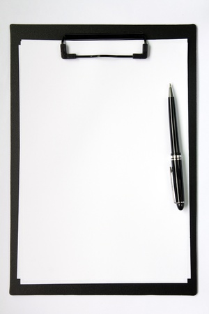 Black color clip board with blank paper and ball pen Stock Photo - 16127085