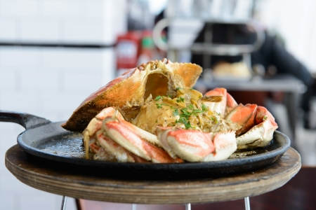 dungeness: Garlic flavor Dungeness crab served on cook pan Stock Photo
