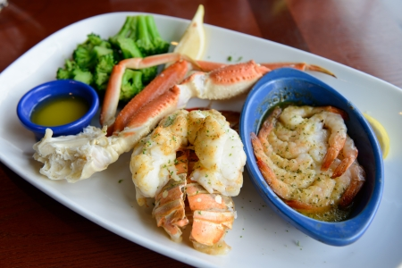 crab meat: Ultimate seafood combo dinner served on plate Stock Photo