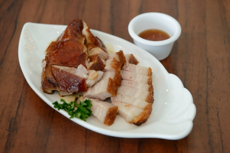 Homemade roasted pork and duck served in white plate photo