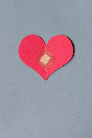 heart break: Broken heart combined with a square bandage
