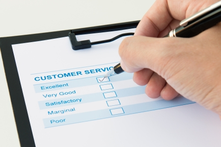 satisfied people: Customer service evaluation form with excellent checkbox ticked Stock Photo