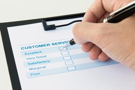 Formulaire d'évaluation du service client avec case cochée excellente Banque d'images