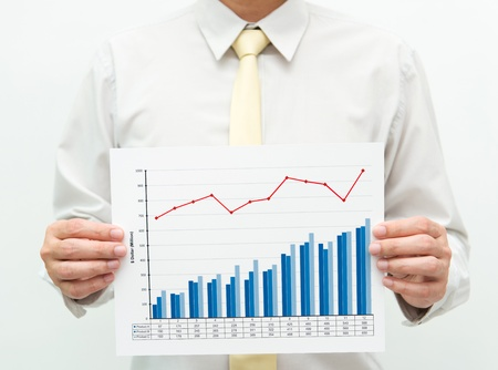 sucess: Man holding a business financial graph and chart Stock Photo