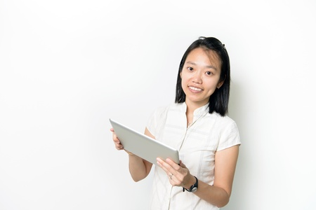 Asian lady with notepad and smile isolated on white background Stock Photo - 18687534