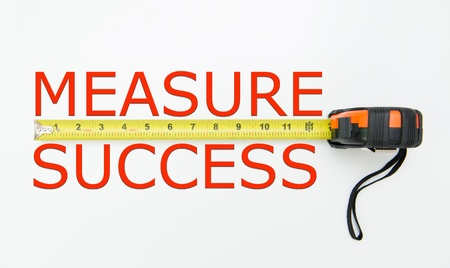 metrics: Measure of success conceptual using measuring tape Stock Photo