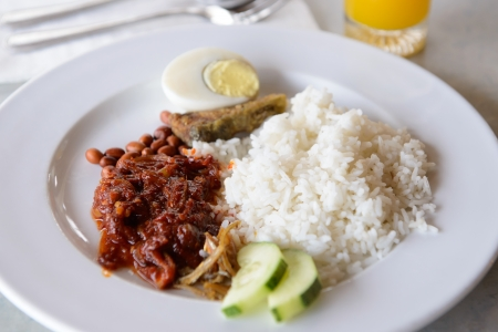 Traditional Malay famous and common food named Nasi Lemak photo