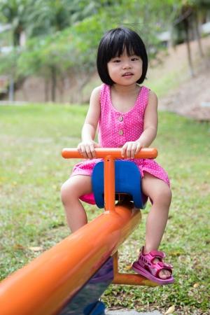 Child plays in an outdoor playground Reklamní fotografie