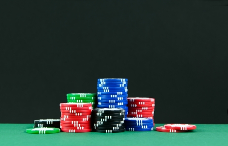 Stacks of colorful poker chips on gambling tables