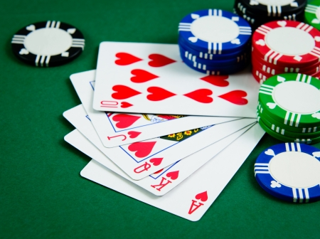 texas hold'em: Playing cards show royal flush in poker game