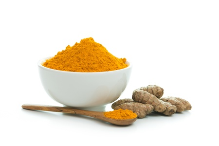 turmeric: Bowl of turmeric powder with fresh turmeric root Stock Photo