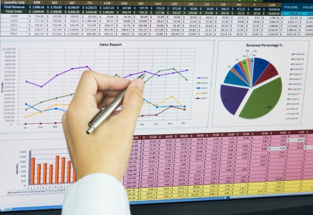 financial reports: Businessman analyzing financial data on computer screen Stock Photo