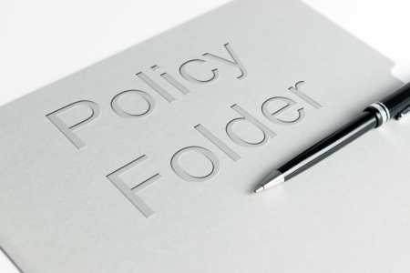 systematic: Closeup shot of policy file holder with a pen Stock Photo